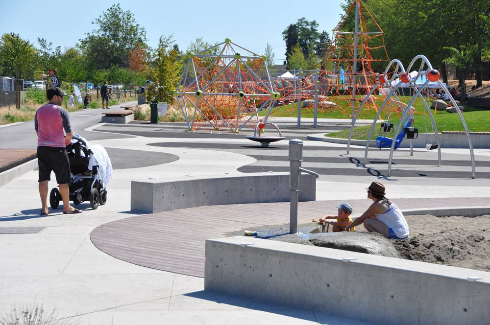 A sand pit with water play elements keeps small children entertained
