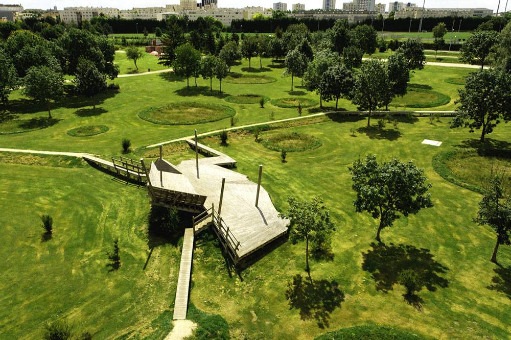 Bird's eye view of wooden play structure and earthworks
