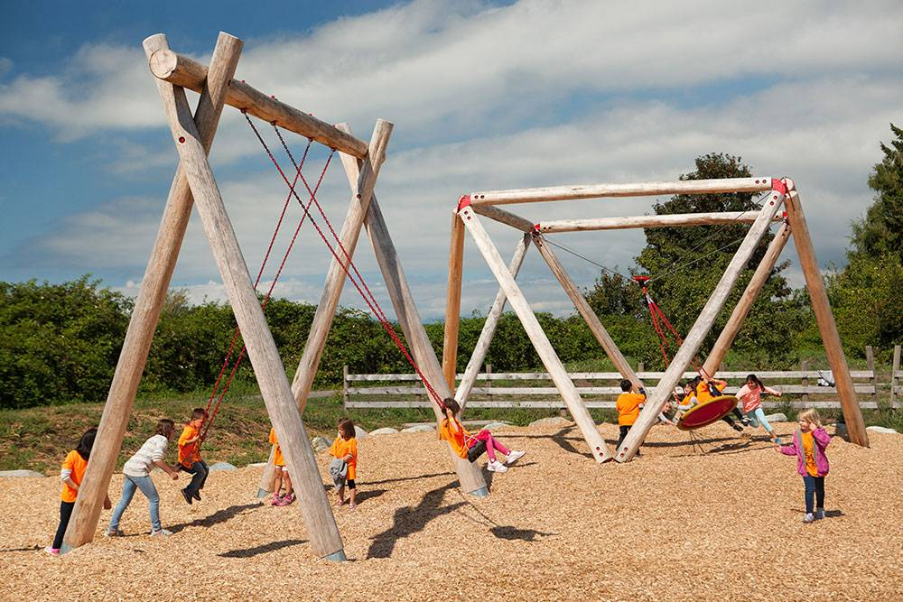 Swing sets feature traditional swings and saucer swings