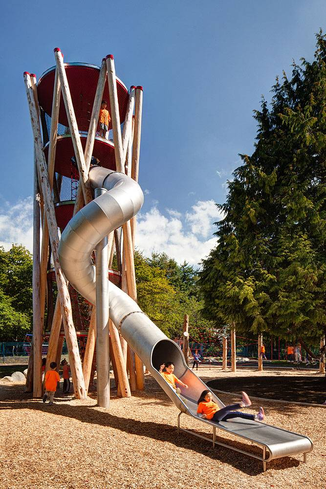 Multi-story play tower with tube slide