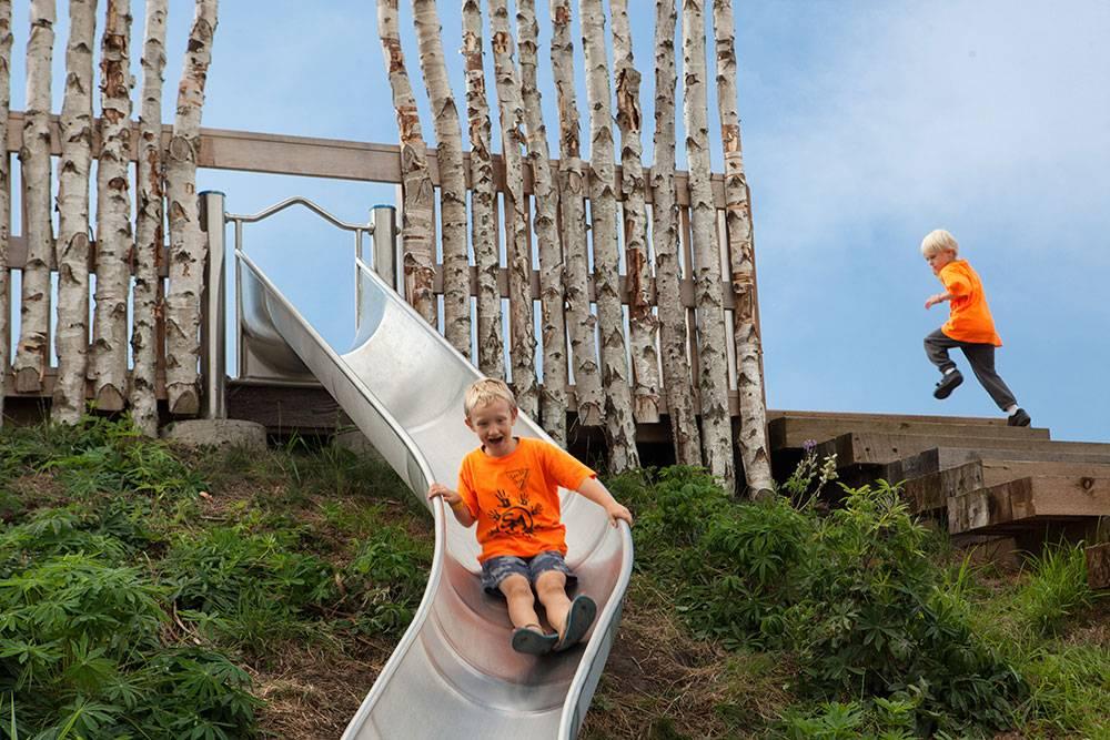 The curving metal slide provides plenty of excitement