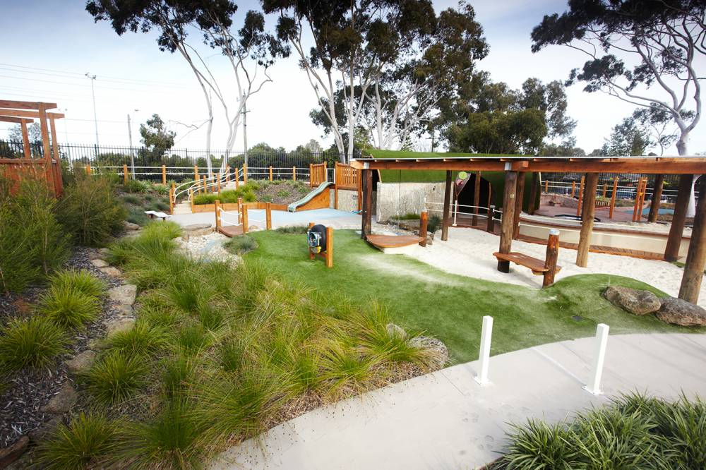 Native planting borders accessible concrete pathway