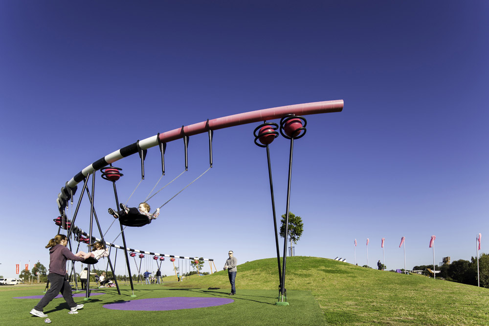 A curving swing set provides ample space to swing