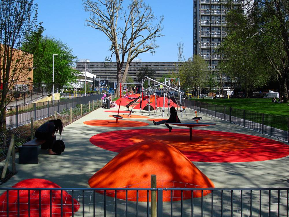 Play area with bright poured rubber mounds