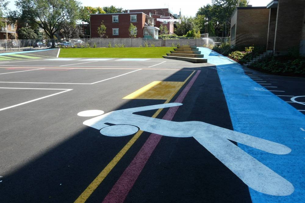 Painted asphalt with grass slope beyond