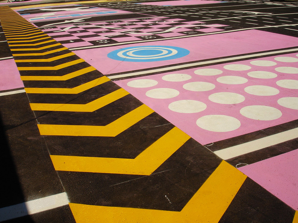 Colourful painted asphalt that suggests different play possibilities