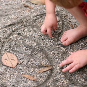 Fine packed gravel can move enough for fingerpainting