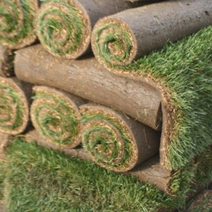 Stacked rolls of sod ready to be installed