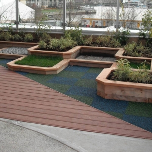 Composite decking beside tiered planters