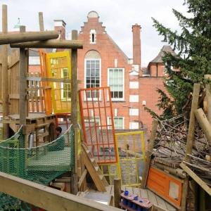 Recycled doors incorporated into play structure