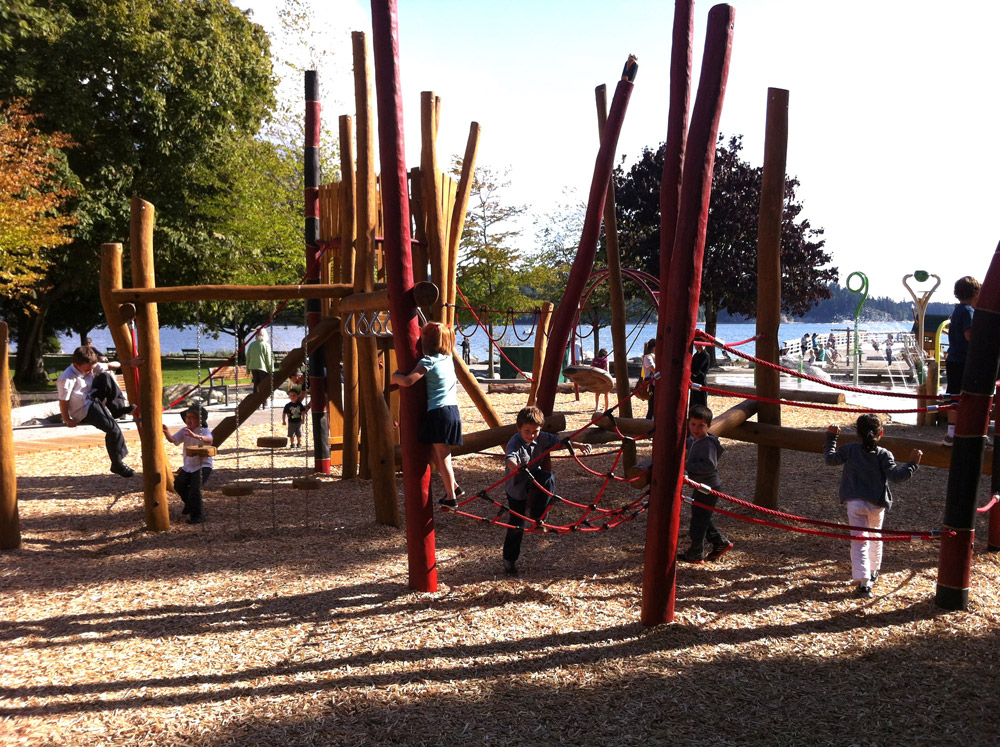 Children playing on the wooden playground