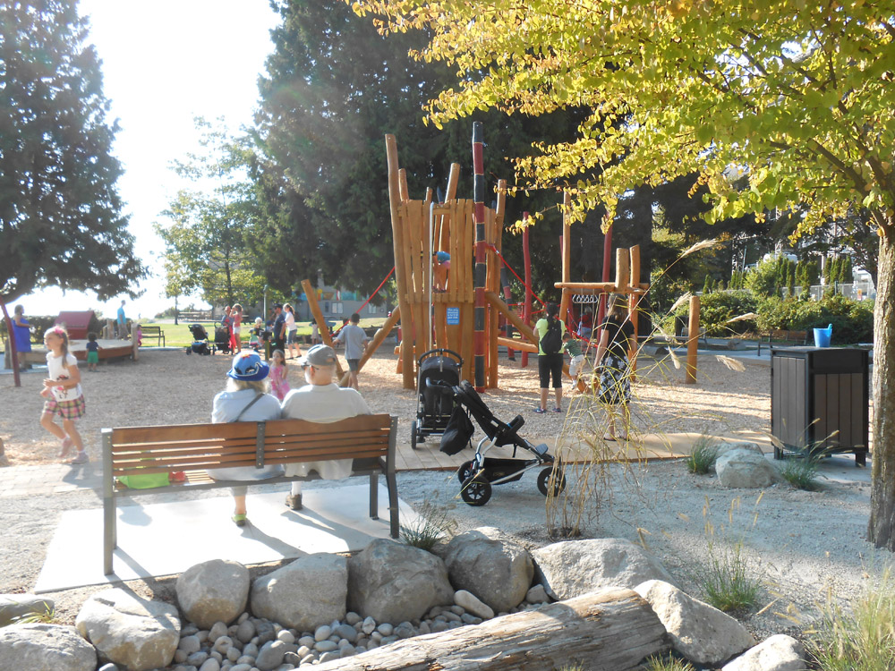 Shaded benches provide a space for caregivers to relax and supervise from