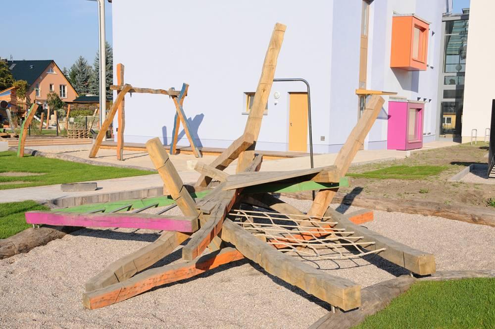 A pile of balance beams creates a nod to a pirate ship