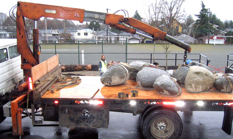 Repurposed boulders are moved into place at General Brock Elementary School (Image: Skala Designs Inc.)