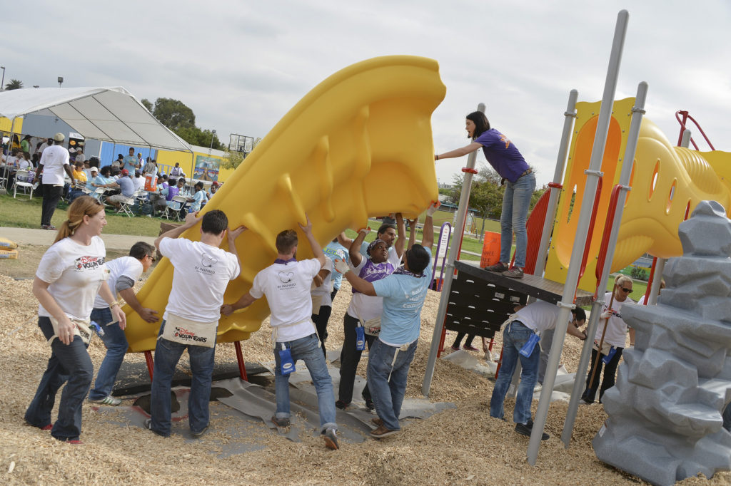Installation of slide on playground structure. Image from Disney | ABC Television Group